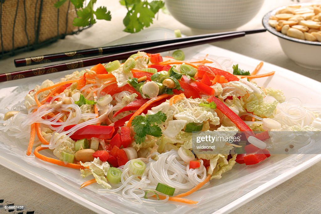 Fresh healthy asian salad with rice noodles and nuts : Stock Photo