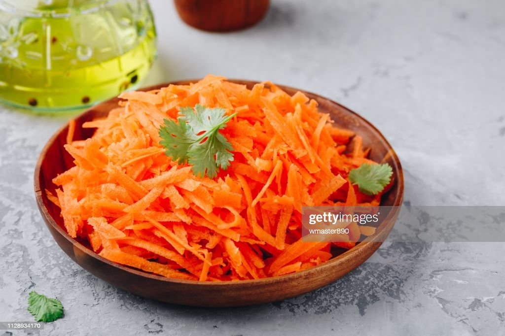 Fresh healthy grated carrot salad in bowl : Stock Photo