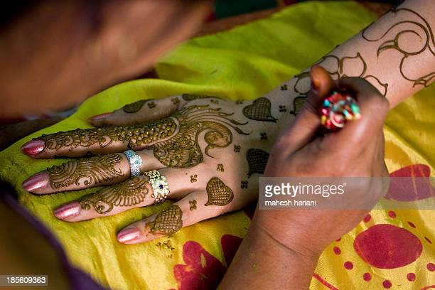 Fresh henna being applied to a hand