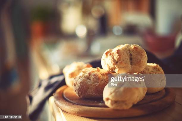 fresh home-baked wheat rolls are ready for breakfast in the morning light - bun bread stock pictures, royalty-free photos & images