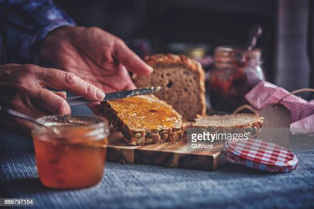 fresh homemade brown bread with marmalade - jam stock pictures, royalty-free photos & images