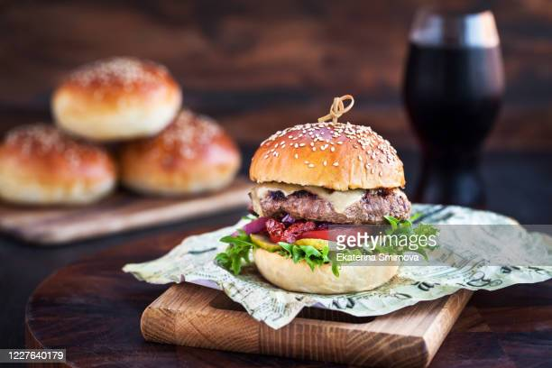 fresh  homemade burger on wooden background, closeup - ハンバーガー ストックフォトと画像
