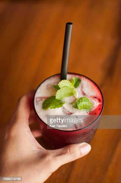 a fresh ice cold lemongrass juice drink on a purple glass - capital region stock pictures, royalty-free photos & images
