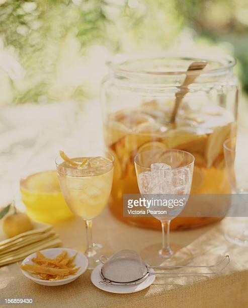 Fresh iced tea with lemons in a large dispenser.