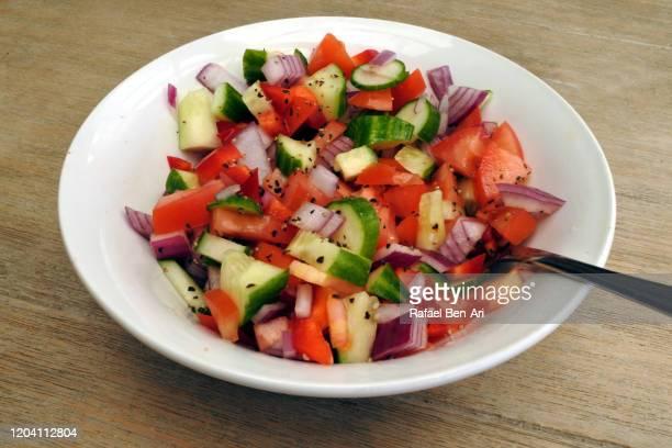 fresh israeli salad served in a bowl - rafael ben ari bildbanksfoton och bilder