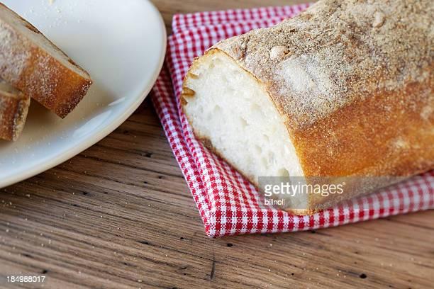 Fresh Italian ciabatta bread on gingham cloth