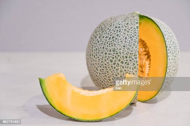 fresh, juicy cantaloupe melon with slices - 果肉 ストックフォトと画像