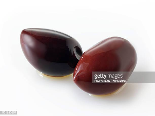 fresh kalamata olives - kalamata olive stock photos and pictures