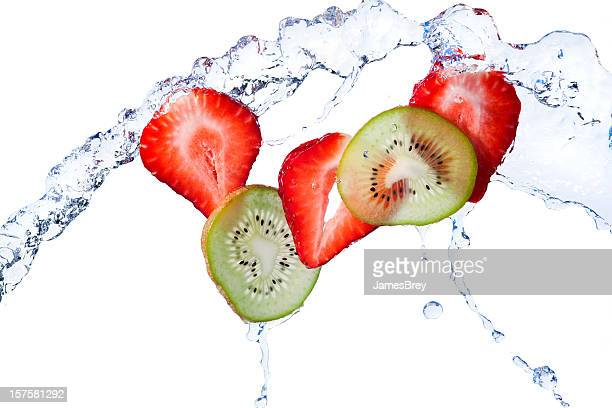 Fresh Kiwi and Strawberry Slices Tossed With Water, White Background