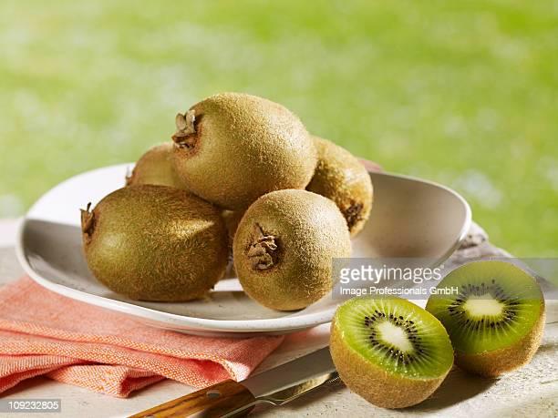 Fresh kiwi fruit on plate, close-up