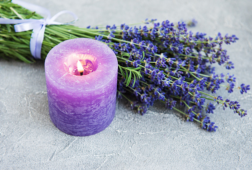 fresh lavender flowers and candle 1150873673