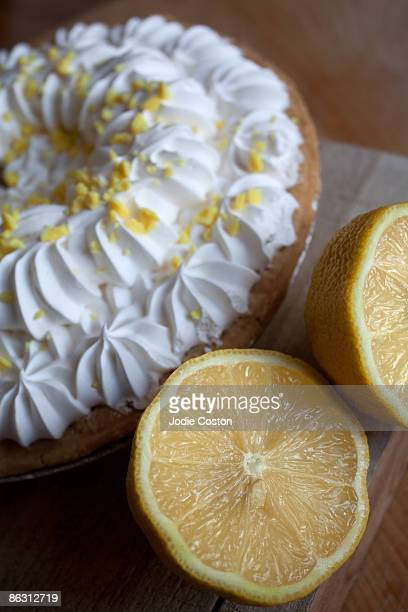 fresh lemons and cream pie - pie in the face stock pictures, royalty-free photos & images
