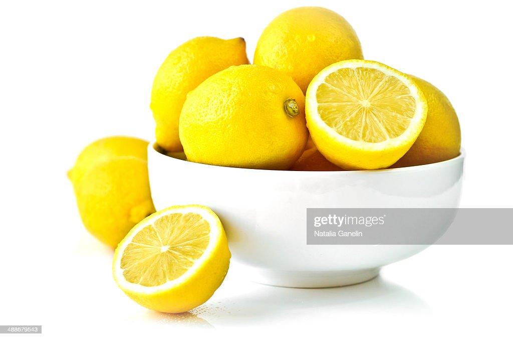 Fresh Lemons In A Bowl Over White High-Res Stock Photo ...