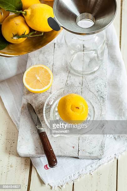 Fresh lemons in squeezer for making lemonade