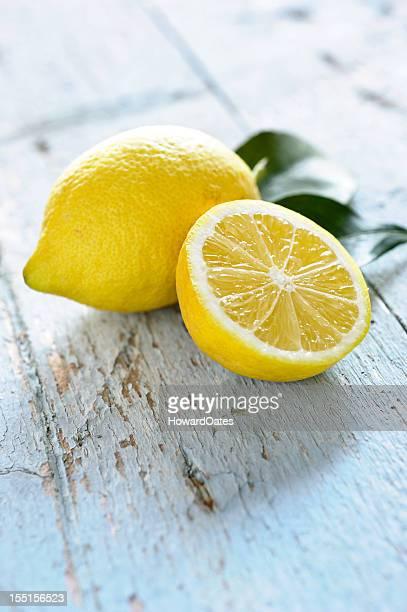Fresh Lemons on blue rustic table