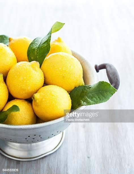 Fresh lemons on strainer