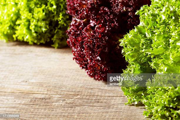 fresh lettuce on wooden table - leaf lettuce stock pictures, royalty-free photos & images