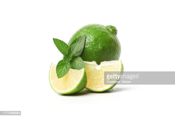 fresh lime isolated on a white background - stock photo - ミント ストックフォトと画像