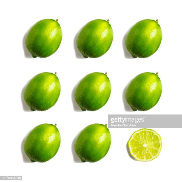 fresh lime isolated on white background - lime stock pictures, royalty-free photos & images