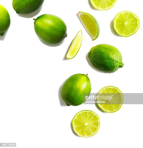 fresh limes on a white background - citrus fruit stock pictures, royalty-free photos & images