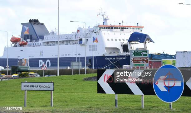 Fresh loyalist graffiti can be seen opposite the entrance to Larne harbour on February 10, 2021 in Larne, Northern Ireland. Port inspection staff...