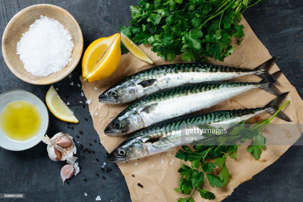 Fresh mackerel fish with ingredients to cook : Stock Photo