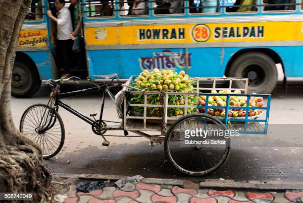 Fresh mangoes for sell in a cart at the side of a road in Kolkata, West Bengal, India.