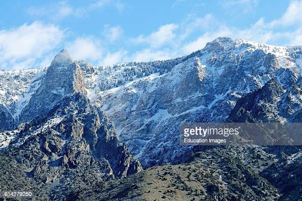 Fresh May snow on rugged Wasatch Mountain peaks along the front range just east of Ogden Utah.
