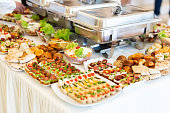 Fresh mediterranean canapes with fresh vegetable salads and baked products.