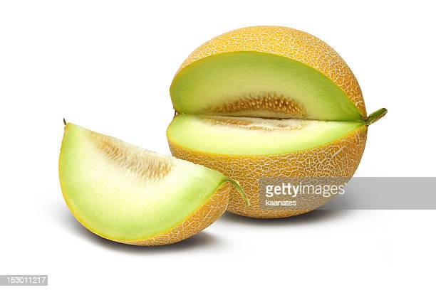 a fresh melon with one slice cut out - muskmelon stock pictures, royalty-free photos & images
