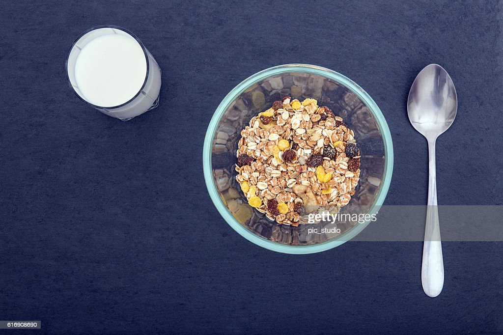 Fresh milk in the glass and cereal breakfast : Stock Photo