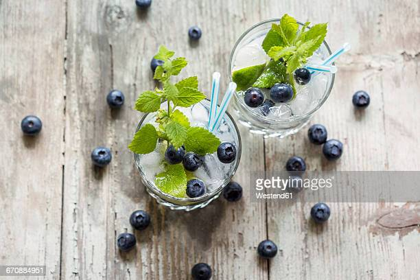 fresh mineral water with blueberries, mint and ice - carbonated water stock pictures, royalty-free photos & images