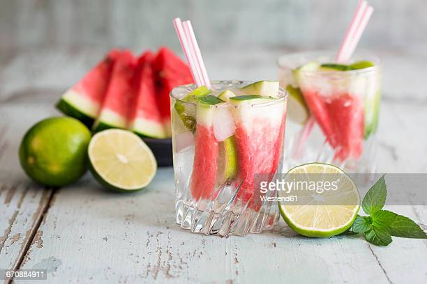 Fresh mineral water with watermelon, lime and ice in glasses