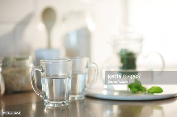fresh mint tea in glasses from glass teapot. - dougal waters stock pictures, royalty-free photos & images