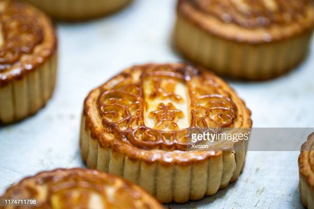 fresh moon cake just baked still hot - moon cake stock pictures, royalty-free photos & images