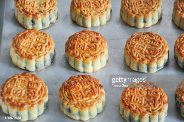 fresh mooncakes from baking ovens. traditional food in mid-autumn festival. - moon cake stock pictures, royalty-free photos & images