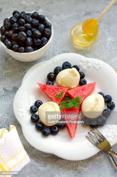 fresh mozzarella salad with bilberries, watermelon, mint and honey - course meal stock pictures, royalty-free photos & images