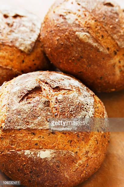 Fresh multi-grain boules, close-up