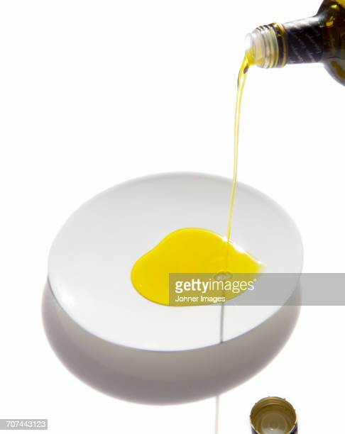 fresh olive oil on white plate - olive oil stock pictures, royalty-free photos & images