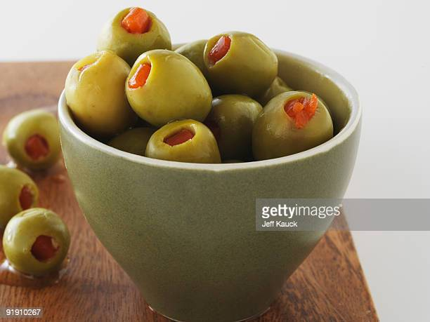 fresh olives in bowl - olive pimento stock photos and pictures