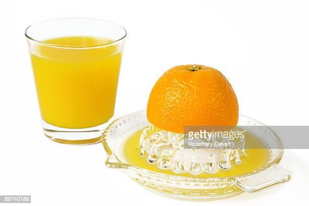 Fresh orange in glass and orange juiced.