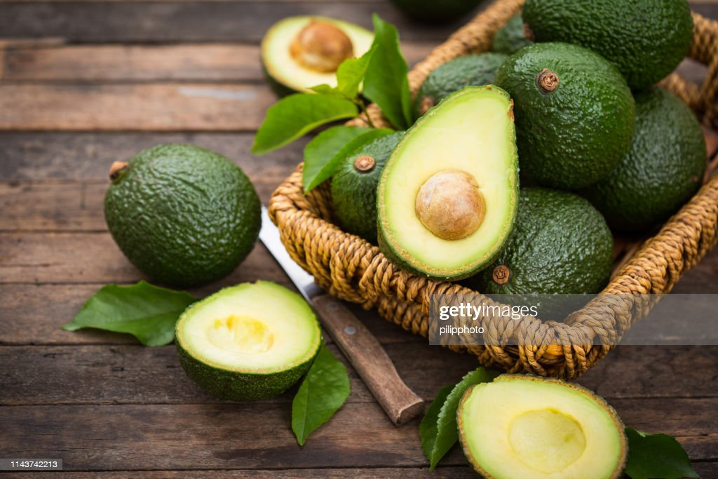 Fresh organic avocado on the wooden table : Stock Photo
