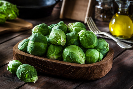 Fresh organic Brussels sprouts shot on rustic wooden table 915334856
