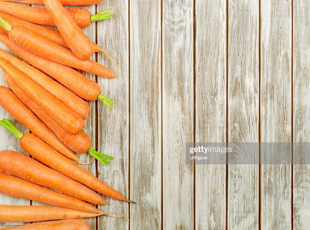 Fresh Organic Carrots on wooden background : Stock Photo