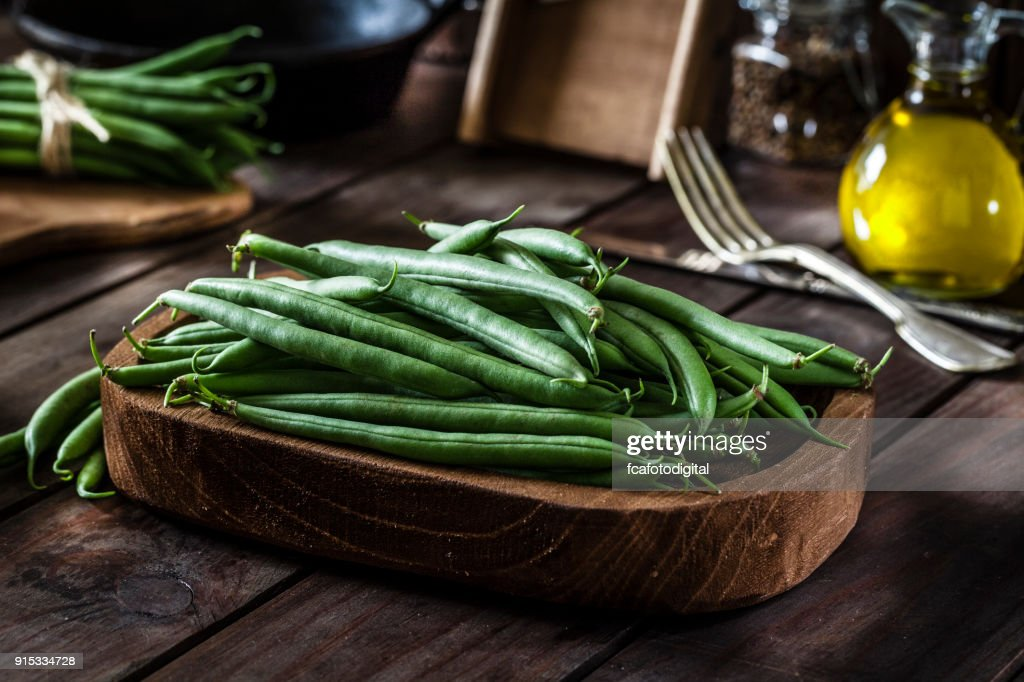 Fresh organic green beans shot on rustic wooden table : Stock Photo