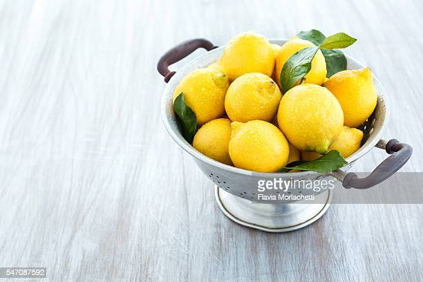 Fresh organic lemons on strainer