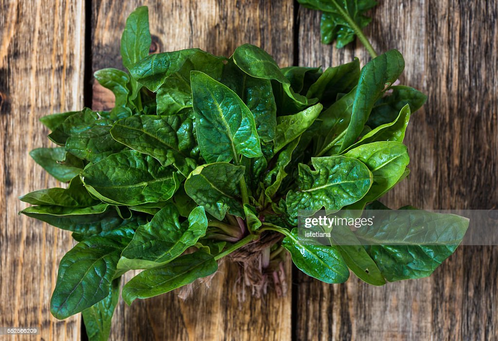 Fresh organic spinach on wooden background : Stock Photo