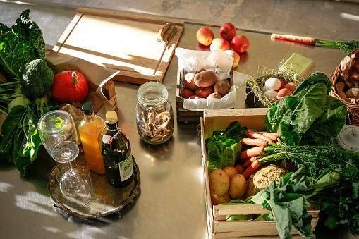 Fresh orgnaic vegetables and fruits in a kitchen - gettyimageskorea
