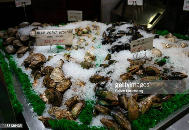 Fresh oysters and mussels lie in a bed of ice at the Fish Tales seafood store in the Brooklyn borough of New York City on October 17 2019 Modern...