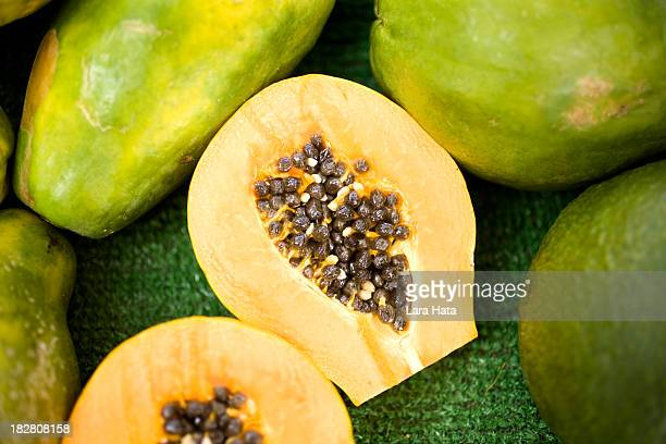 fresh papaya cut in half with seeds inside - papaya stock photos and pictures
